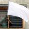 Bandiera Bianca della speranza sventola nei quartieri poveri della Malesia